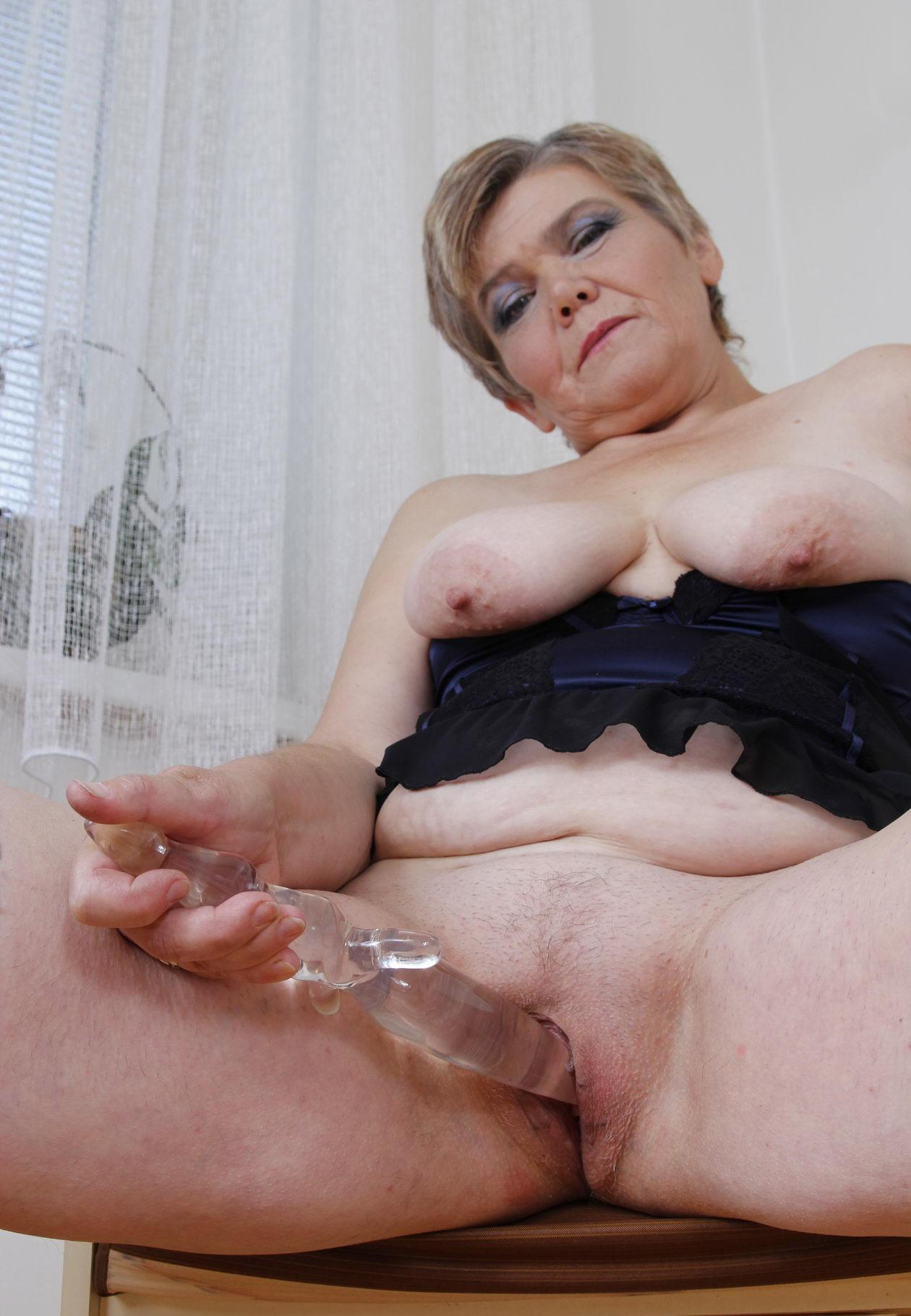 Nadia a beautyful granny is playing a glass dildo