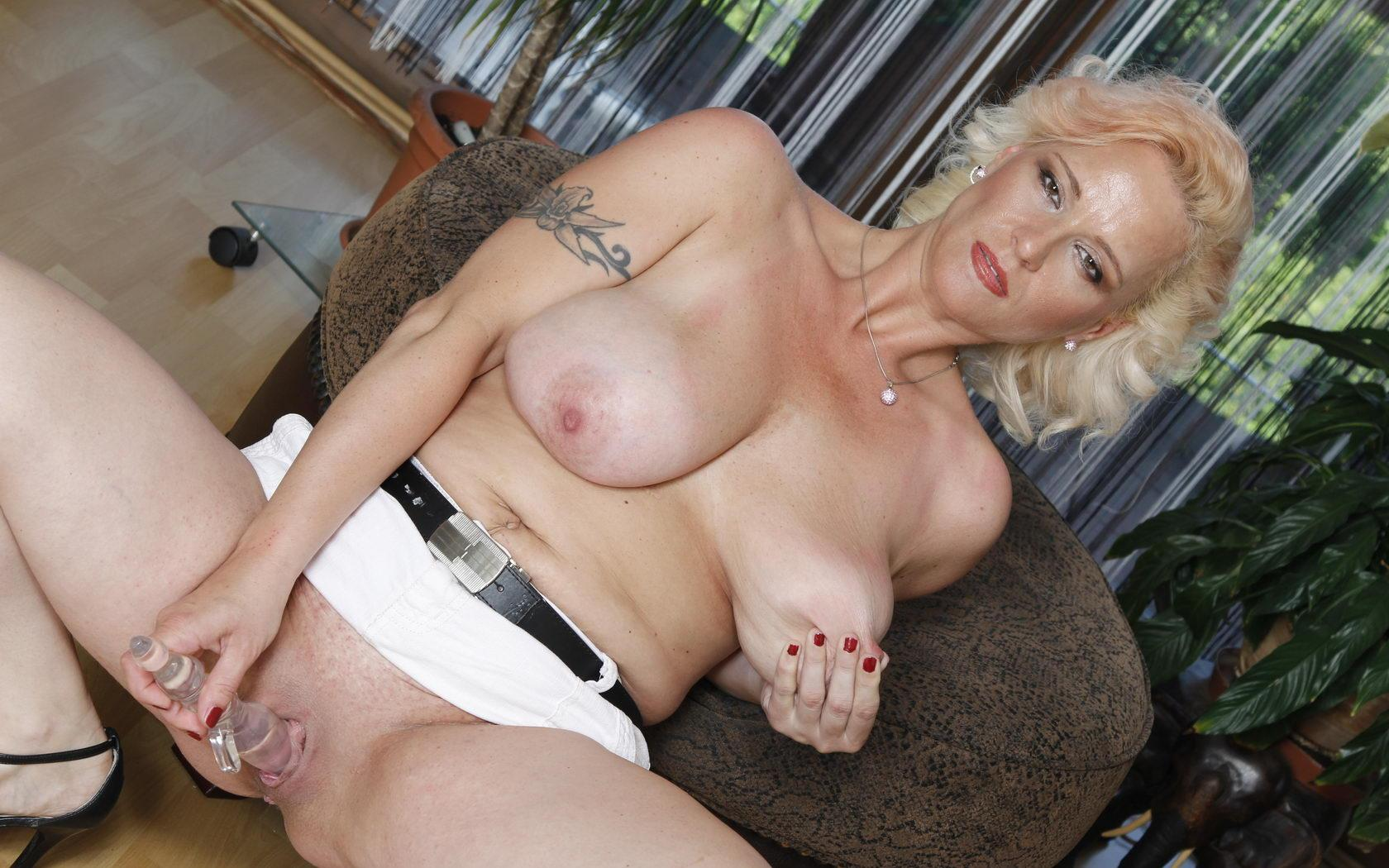 Regina a wet granny is an attractive older woman who invites you to cum on her boobs