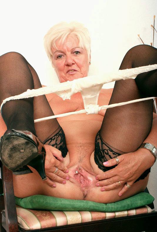 Teresa a golden granny taking her panties down