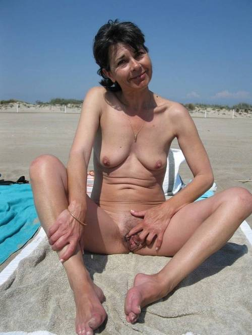 Gabriella a beautyful granny spreading her twat at the beach