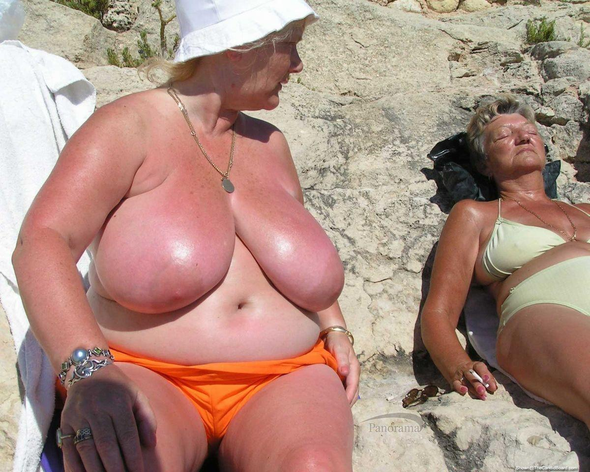 perverted granny is not shy together with her plumper girlfriend showing tits at the beach