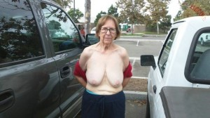 Britney a 79 old eager FLASHING GRANNY posing her saggy old tits on a parking lot