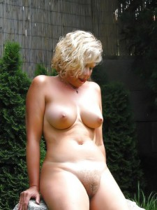 Hayley a 68 old debauched HOMEMADE GRANNY posing in her backyard