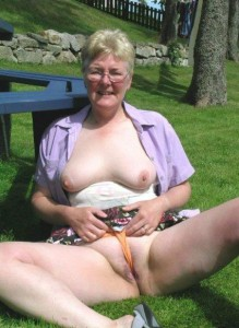 Rachael a 62 old perverted FLASHING GRANNY rubbing her clit with her panties in the park