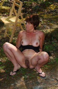 Sadie a 61 old rude FLASHING GRANNY flashing her huge hairy hole  outdoors near a nudist camp