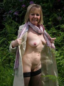 Michaela a 66 old doomed FLASHING GRANNY teasing outdoors in her sexy hold ups