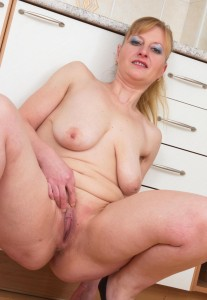 Jenna a 63 old cravng FLASHING GRANNY spreading her lusty granny pinkhole