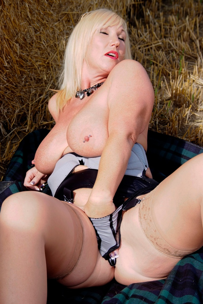 horny mature mom shows her genitals at the countryside