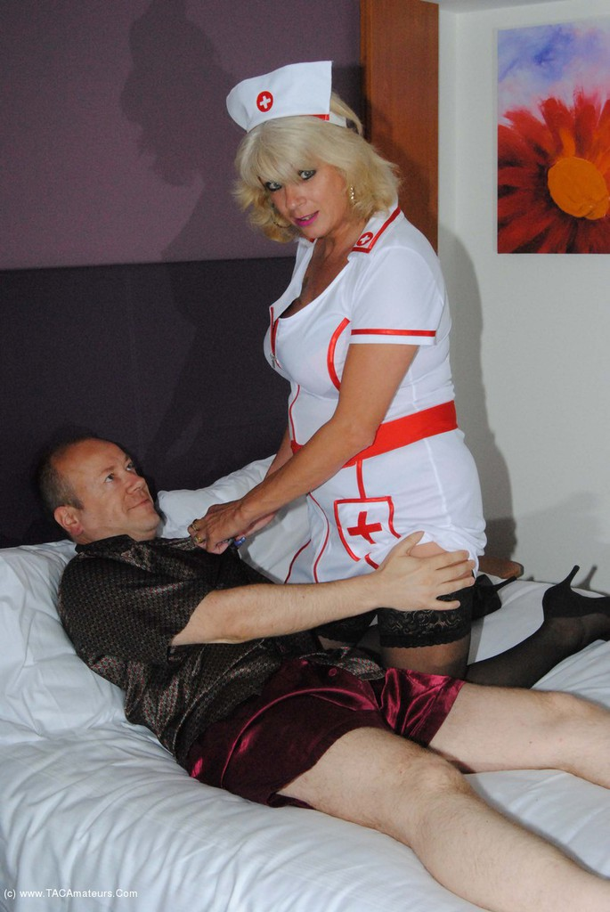sexy old nurse takes care about a young patiens hard penis