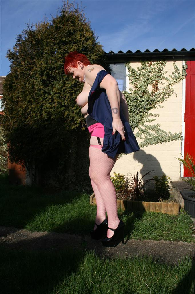 sweet fatty granny shows her pink panties