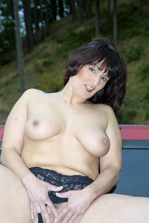 sexy american amateur homemade mature poses in front of her ford
