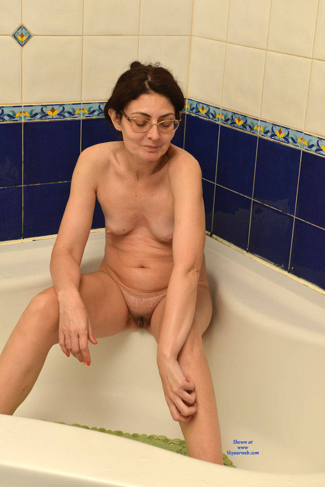 skiny french granny shaves her small pussy in the bathroom while her granson is playing with his new tablet