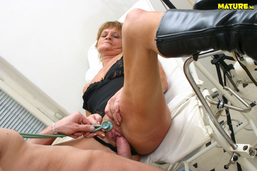 granny taking a seat at the gynacologist doctor and request a deep vagina inspection