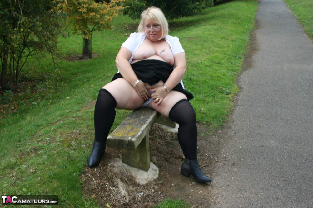 slutty bbw granny is taking a piss and shaking her wet panties outdoors