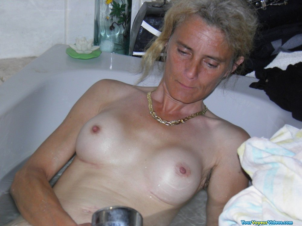 by accident spying on naked grandmother while shes relaxing and taking a bath