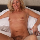 slender golden ager pamela, aged 62  toys her tighty hairy granny cunt with her fingers only #11_thumb