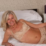 slender golden ager pamela, aged 62  toys her tighty hairy granny cunt with her fingers only #7_thumb