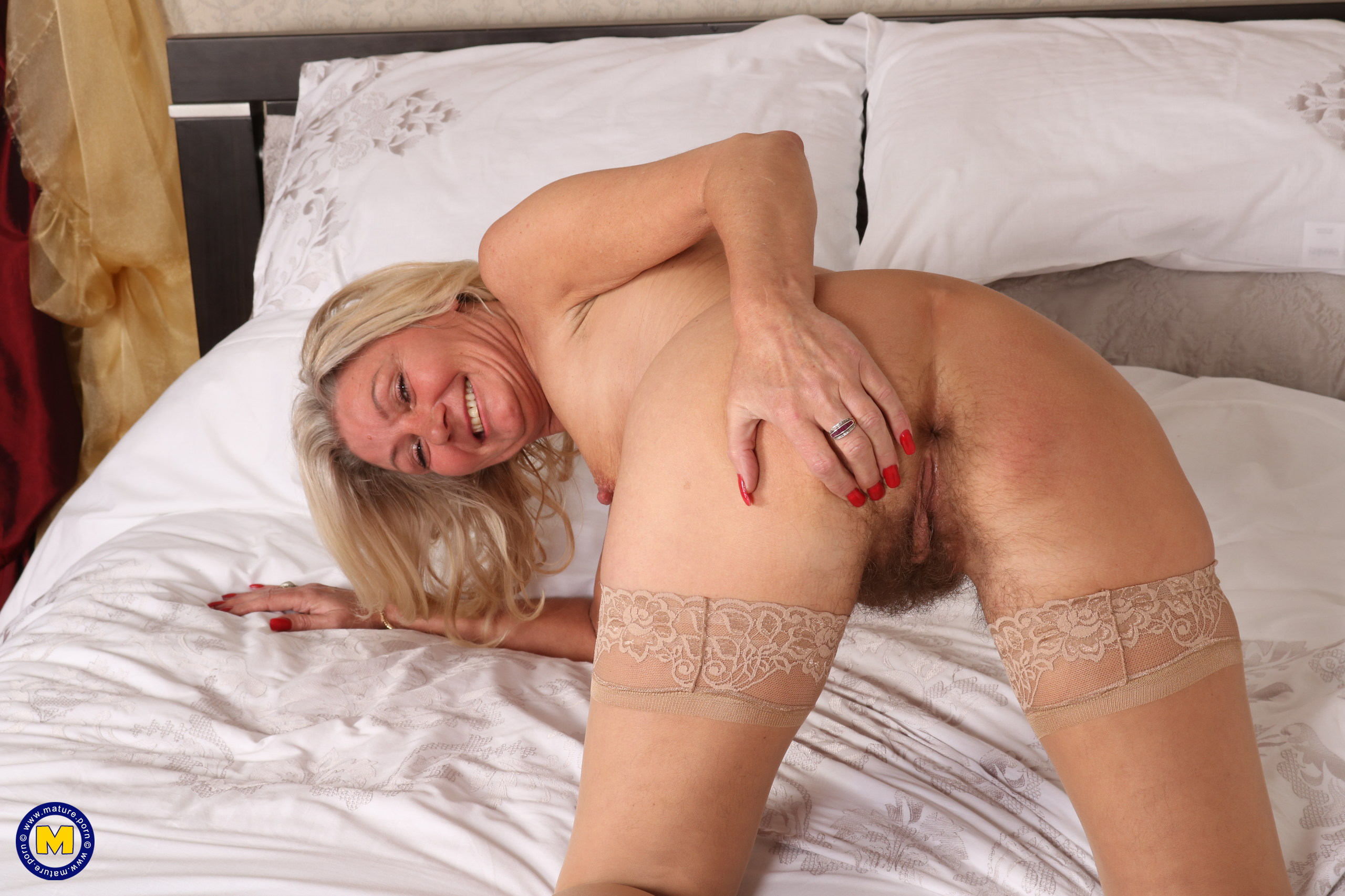 slender golden ager pamela, aged 62  toys her tighty hairy granny cunt with her fingers only #1
