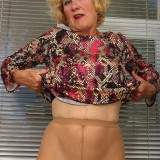 posh granny Molly posing in superb stockings and fucking herself thru nylons picture 13