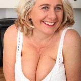65 years old retired lady performing kinky stripease picture 7