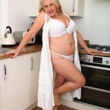 65 years old retired lady performing kinky stripease picture 14