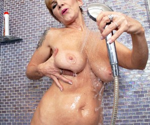 naked grandmother with prefect body jerking her ole little pussy under the shower
