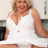 65 years old retired lady performing kinky stripease picture 11