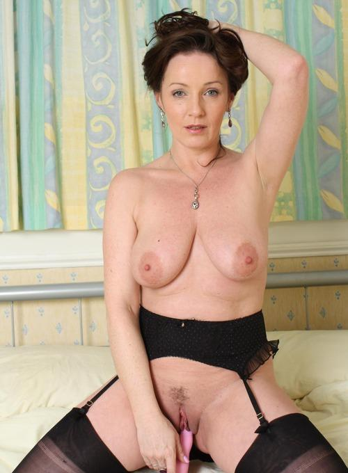 Meredith a lustfull granny inserting a hard piece of dildo in her old pussy