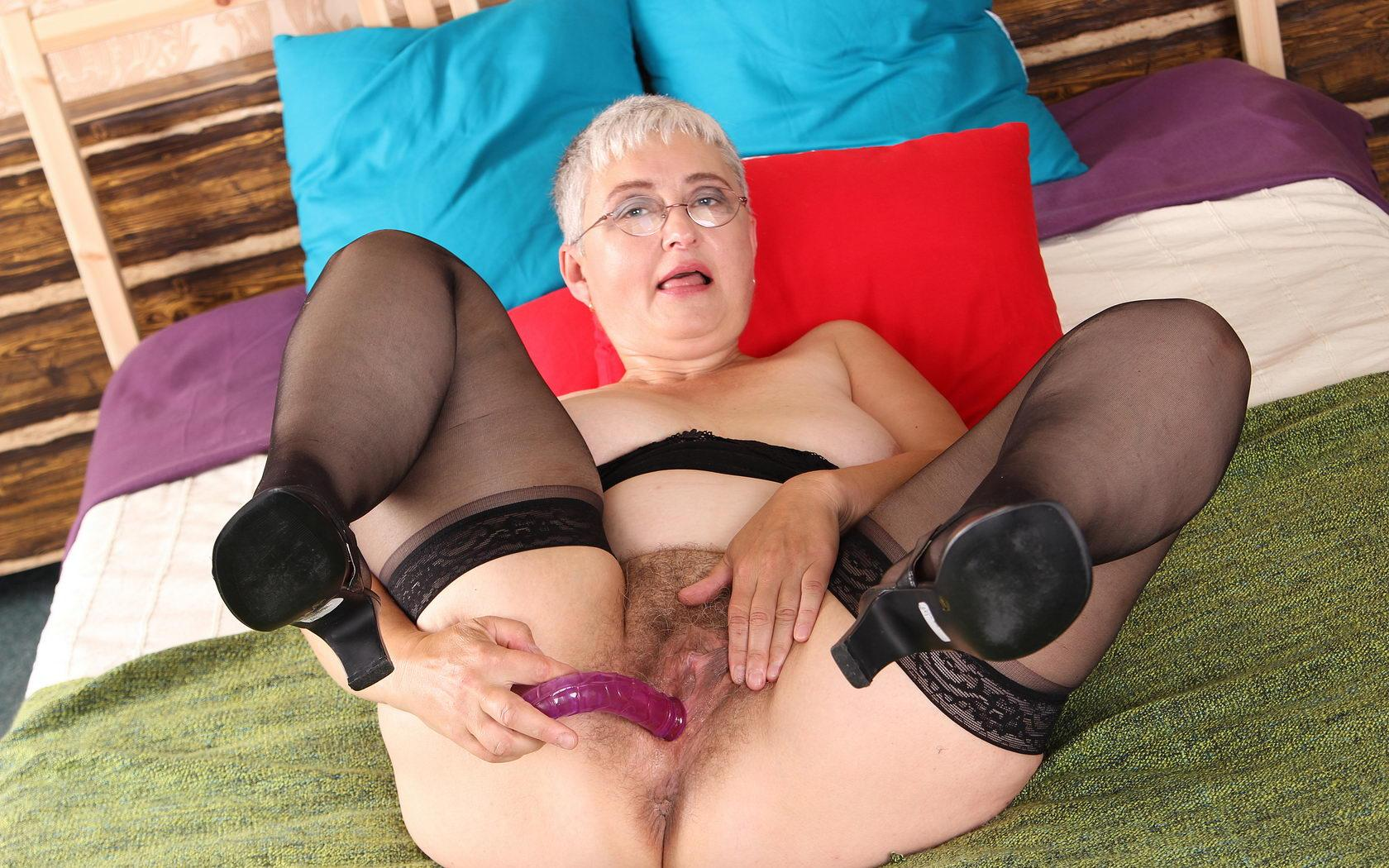 Madison a seductive granny wants to make you cum inside her hairy cunt and on her ass