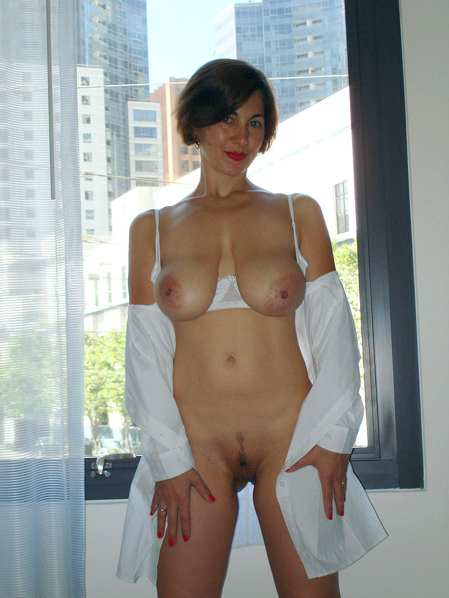 Jenny a arround 50 years old old cute SEXY MOM doing a striptease in the hotel room