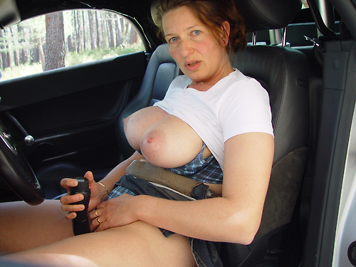 Alice a 63 old amorous BIG TITTED GRANNY play her old clit in a dacia