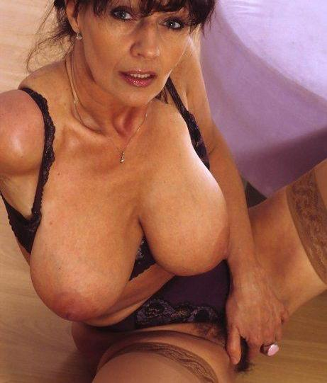 Kassandra a 65 old sexy BIG TITTED GRANNY offering you to cum on her huge tits