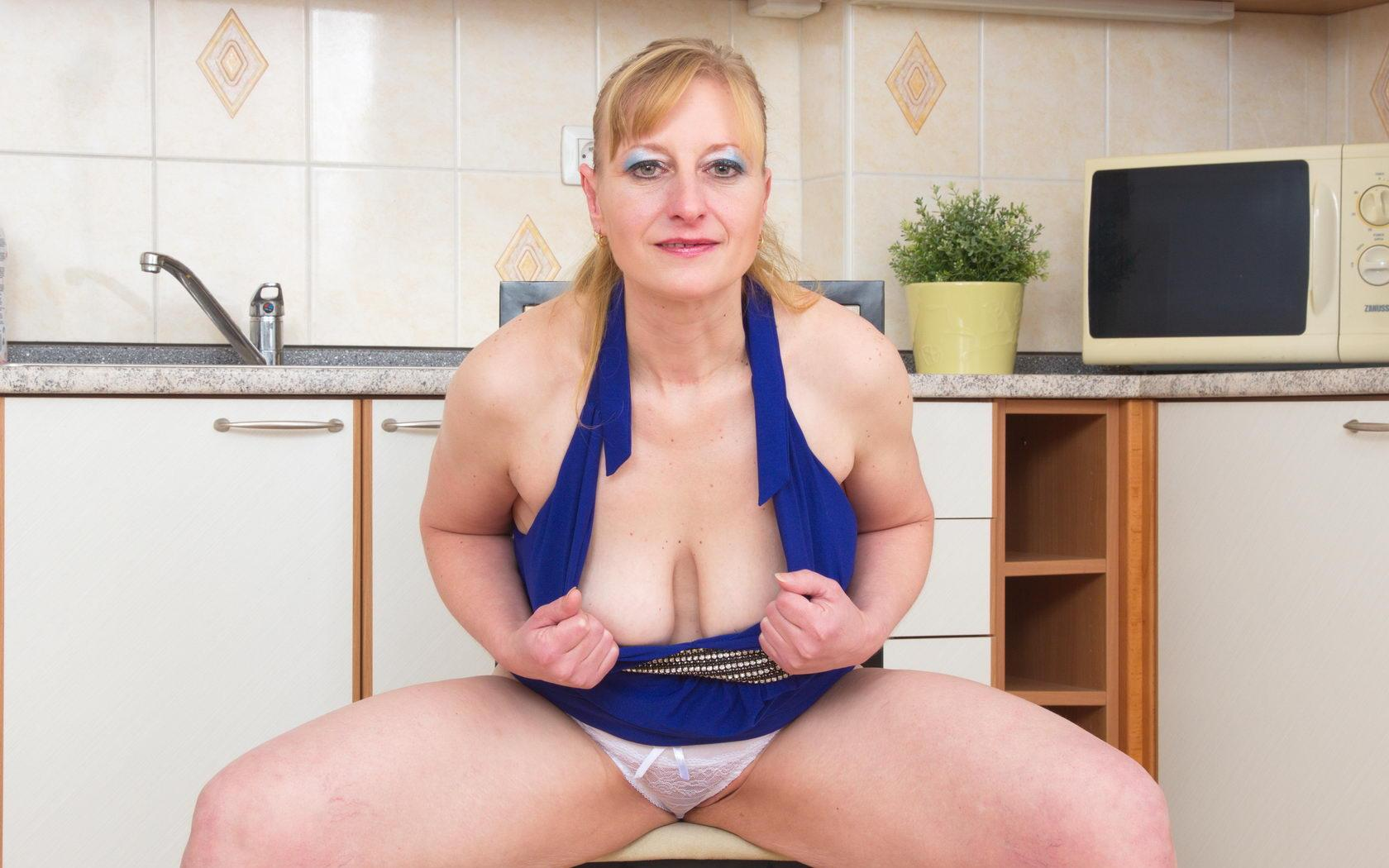 Mckenzie a 63 old naughty FLASHING GRANNY doing a downblouse tease