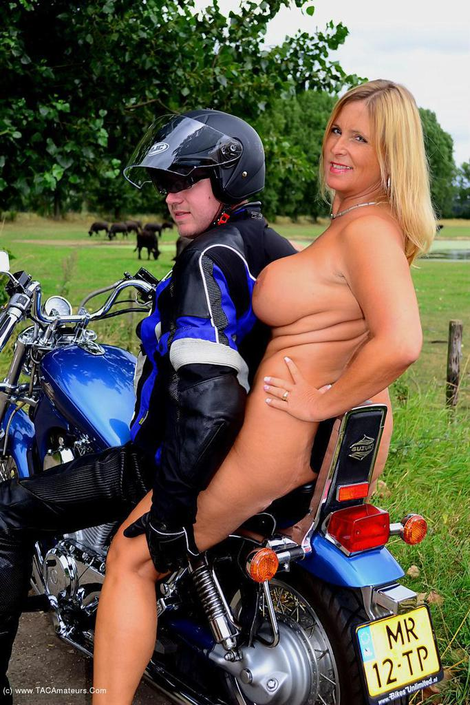 adorable biker mom riding nude on a harley with her younger lover