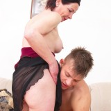 older experienced woman shows a young boy how to make love #3