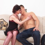 older experienced woman shows a young boy how to make love #5