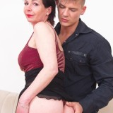 older experienced woman shows a young boy how to make love #9