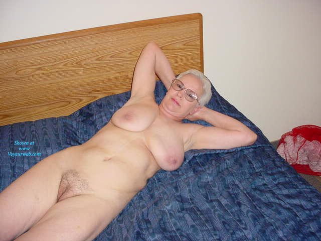 70 years old hottie granny posing on her bed