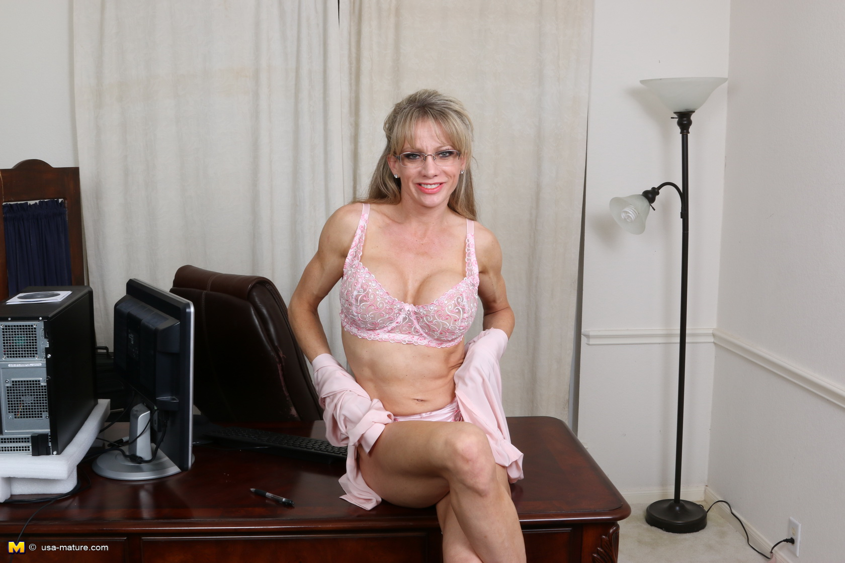 hot office granny performing a homemade striptease on her working desk
