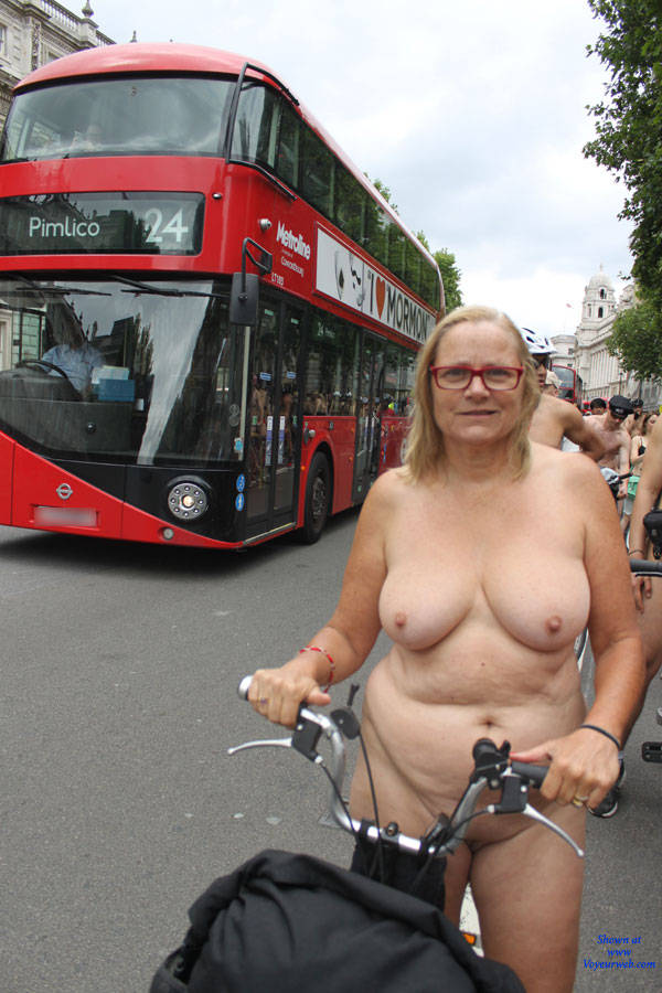 Huge scandal – 70 years old naked british granny going shopping downtown london with a bike