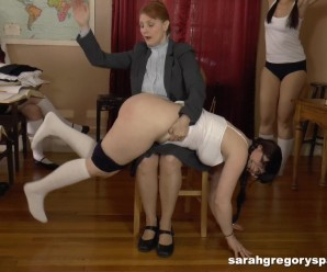 perverted granny teacher spanks two virgins with her bare hands