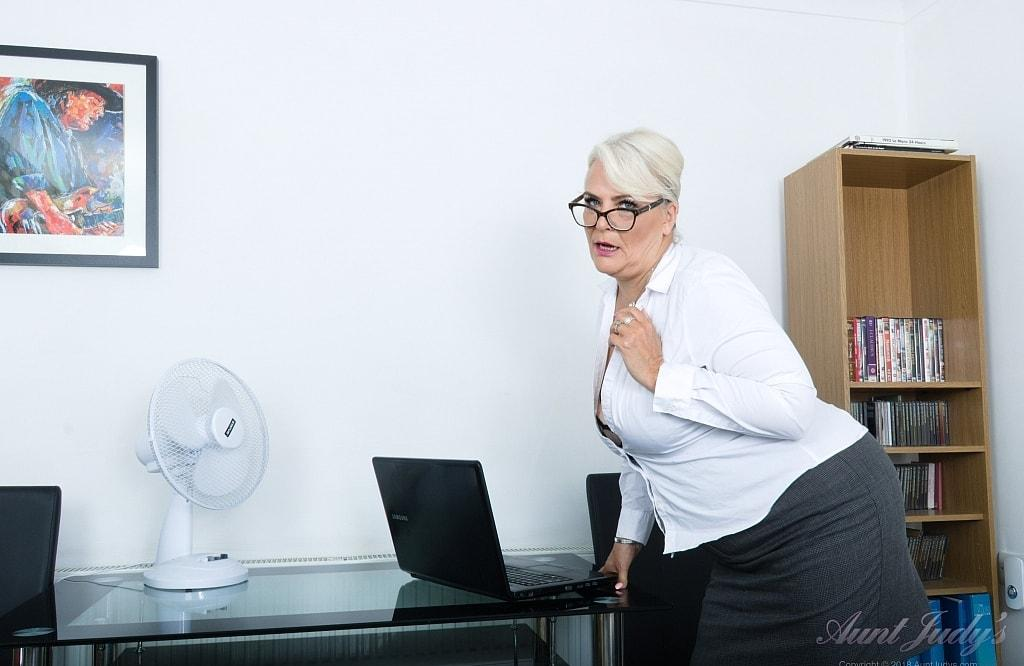 her last day in the office before she retires - she shows her big old pussy picture 2