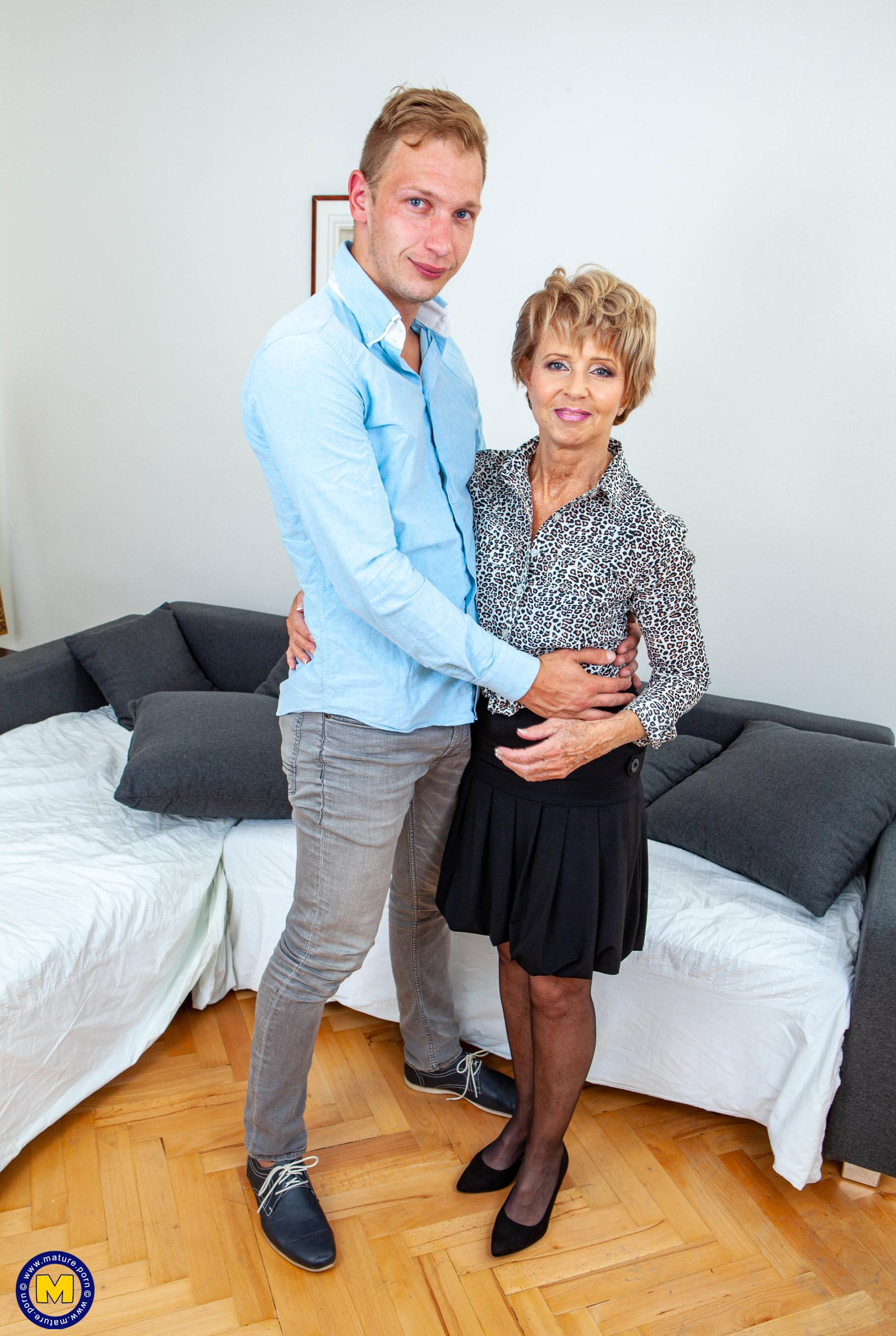 helpful senior consultant lady helping a young bro out with hand and blowjob picture 2